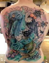 Big coloured heron bird tattoo on back