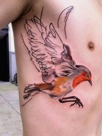 Bird tattoo on the side
