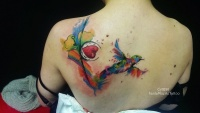 Clover and swallow watercolor tattoo by carditattoo