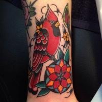 Coloured bird tattoo on arm