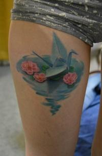 Coloured origami bird tattoo by Andrey Lelyuk