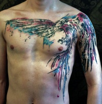 Large colored bird tattoo on chest