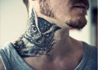 Owl bird tattoo on the neck