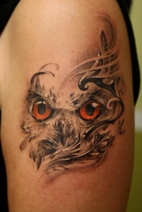 Owl eyes tattoo