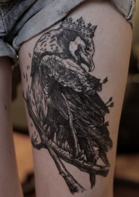 Raven tattoo on  leg