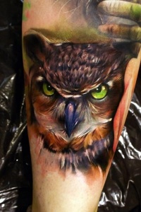 Tattoo owl on hand