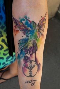 Watercolor tattoo bird on leg